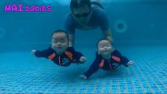 双胞胎被宝爸仍在水里学游泳,就看宝宝们此时